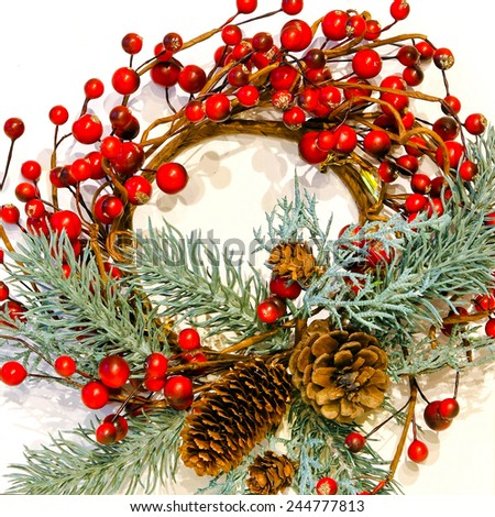 Wreath decoration with red berries and cones - stock photo