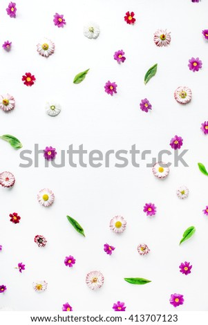 wreath frame heart with roses, chamomile buds, leaves, petals isolated on white background. flat lay, overhead view - stock photo