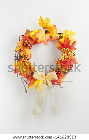 wreath in autumn colors over white - stock photo