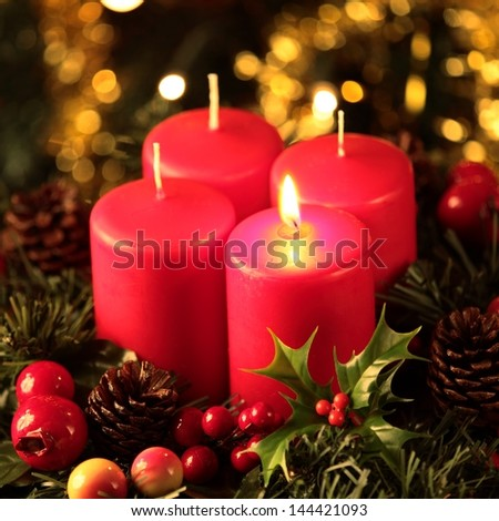 Wreath with one burning candle - stock photo