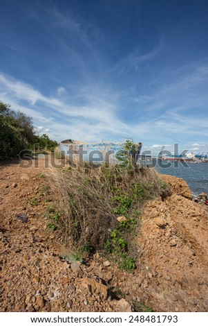wreck boat on land with blue sky in Thailand - stock photo