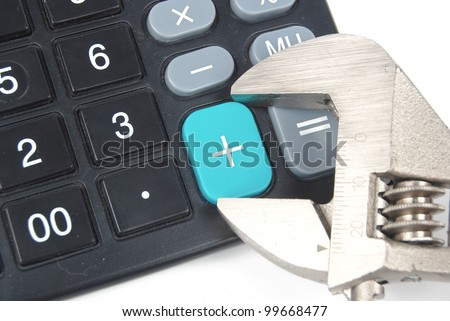 Wrench and calculator - stock photo