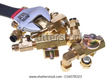 Wrench and plumbing accessories - stock photo