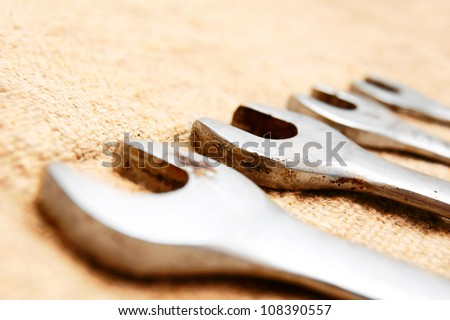 Wrenches on a fabric . - stock photo