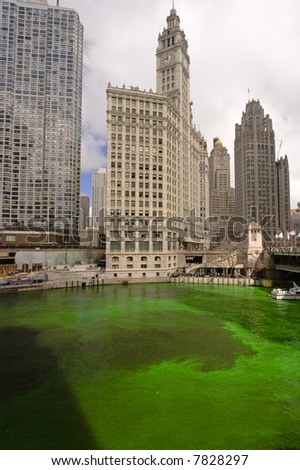 Wrigley Building and green river - stock photo