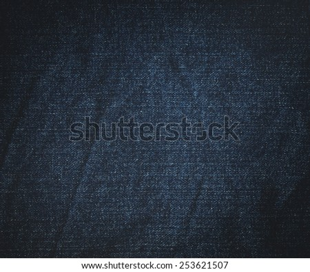 wrinkle dark blue jeans background - stock photo