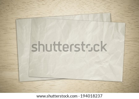 Wrinkle recycle papers on wood board. - stock photo