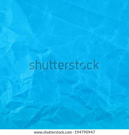Wrinkled blue paper fragment as a background texture - stock photo