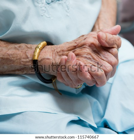 wrinkled hands  of old woman. - stock photo