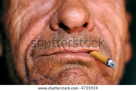 wrinkled mouth and cigarette - stock photo