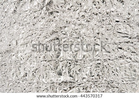 Wrinkled tinfoil background shot from close - stock photo
