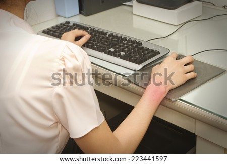 Wrist pain from working with computer,Carpal tunnel syndrome - stock photo