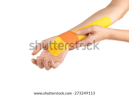 Wrist treated with tex tape therapy - stock photo