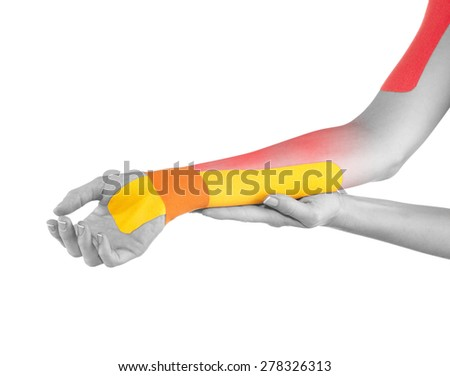 Wrist treated with tex tape therapy. - stock photo
