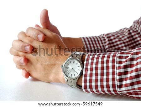 Wrist watch on hand - stock photo