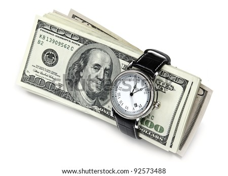 Wrist watch wrapped around a roll of 100 usa dollar banknotes - stock photo