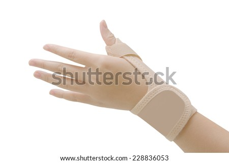 wrist with brace ,wrist support for carpal tunnel syndrome - stock photo