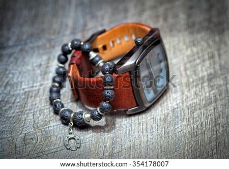 wristwatch with a leather strap and bracelet jewelry - stock photo