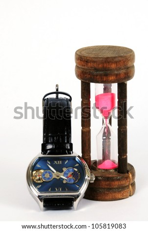 Wristwatches & hourglass - stock photo