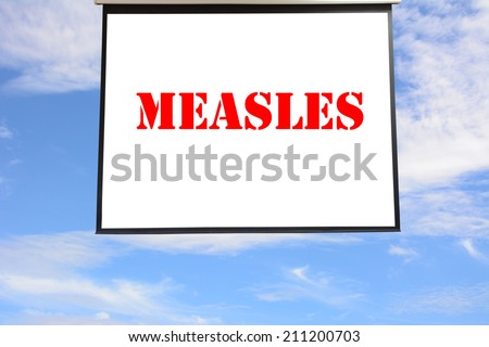 Write MEASLES in The hanging projection screen - stock photo