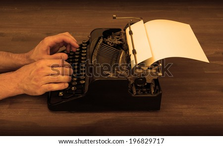 Writer or reporter behind the typewriter in retrostyle - stock photo