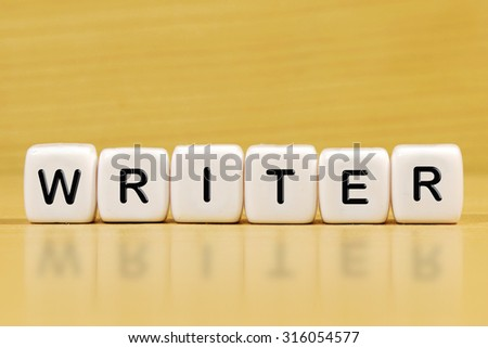 WRITER word on blocks - stock photo
