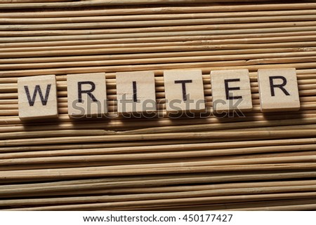 Writer word on wood abc blocks at wooden background. - stock photo