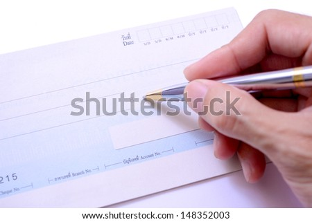 Writing a check - stock photo