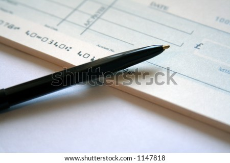 Writing a cheque 2 - stock photo