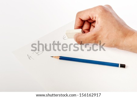 Writing and erasing pencil on a paper - stock photo