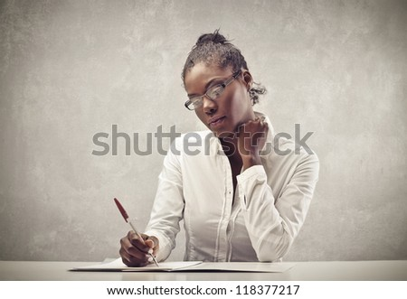 Writing black woman with a white shirt - stock photo