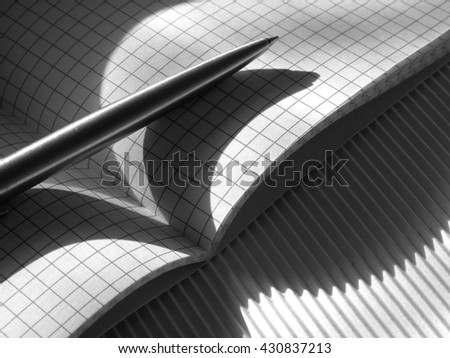 Writing-book with pen on the crepe paper and shadow lines - stock photo