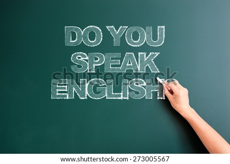 writing do you speak english on blackboard - stock photo