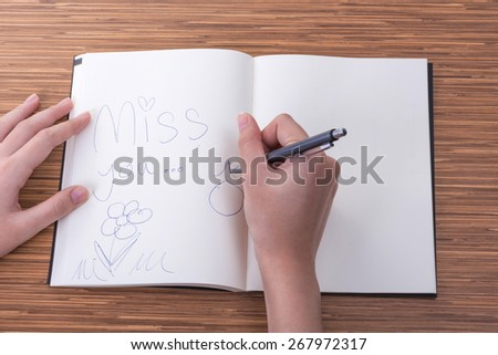 writing, hand, book, notebook, accounting, desk, account, pen, open, organizer, woman, businesswoman, paper, closeup, page, table, pad, white, sitting, business, study, diary - stock photo