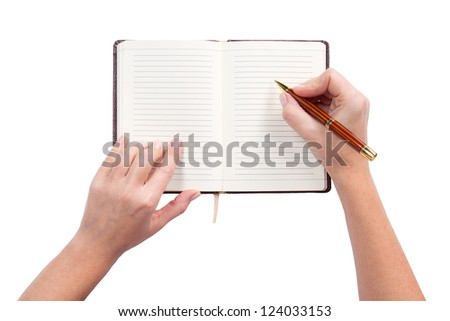 Writing in a notebook, isolated white background - stock photo