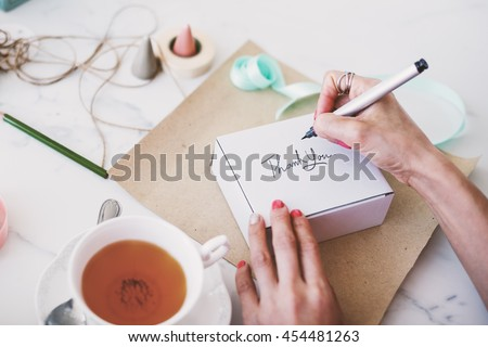 Writing Message On Present Package Decorations Concept - stock photo