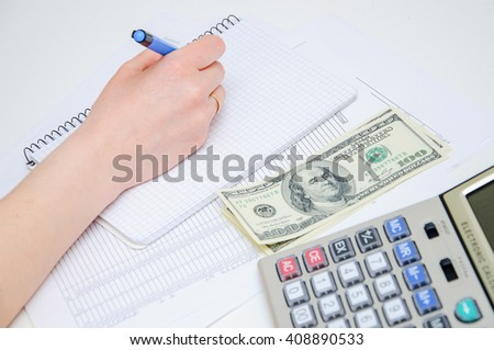 Writing of the report on work, leading of financial results. Calculation of the income. - stock photo