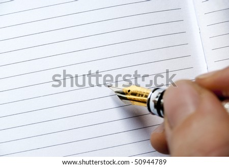 writing on a blank agenda - stock photo