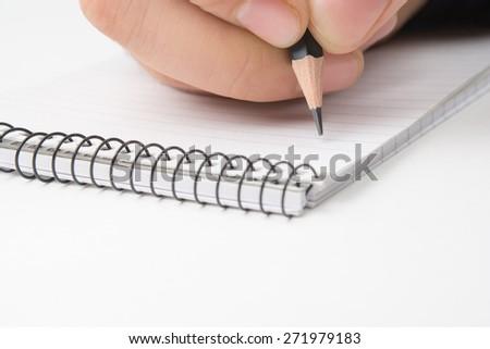 Writing on notepad. Close up, isolated on white - stock photo