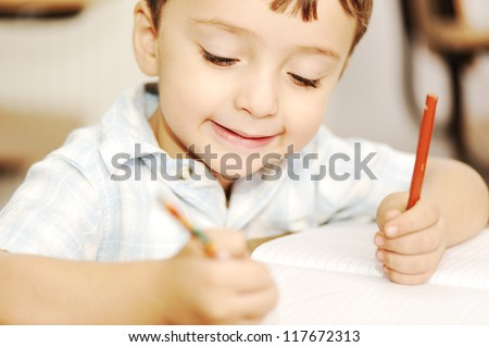 Writing  schoolboy in the classroom - stock photo