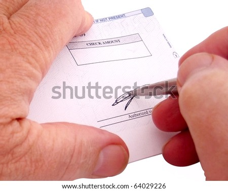 Writing the Check - stock photo