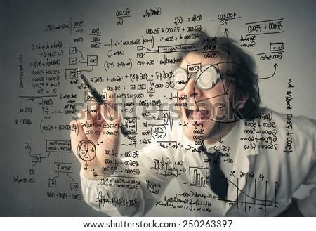 Writing the secret formula  - stock photo