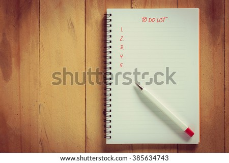 writing to do list on notepad with pen - stock photo