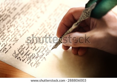 Writing with quill pen last will and testament or concept for law, legal issues or author - stock photo