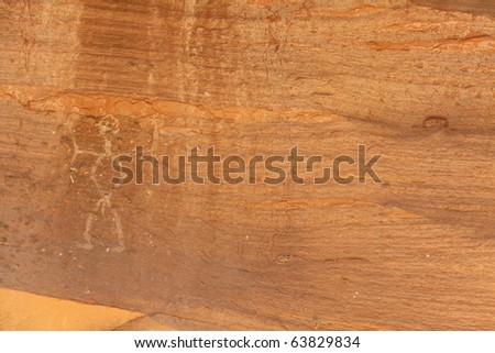 writings carved into a cliff wall - stock photo