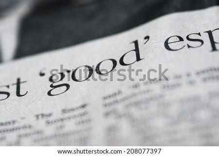 Written good. Written good on real newspaper, shallow dof.  - stock photo