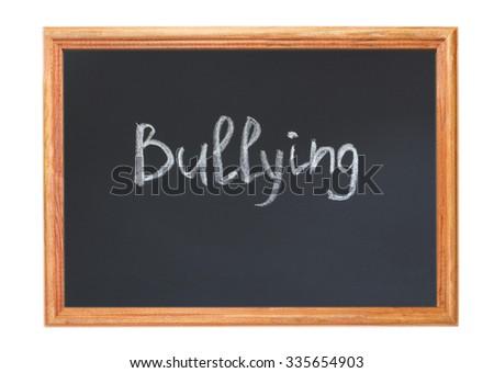 Written in white chalk on a blackboard - bullying - stock photo