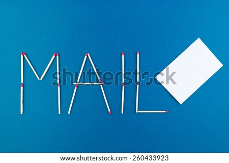 Written mail made with matches - stock photo