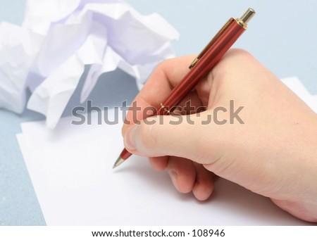 Writting on empty sheet of paper - stock photo