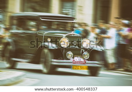 Wroclaw- August 18: Cadillac Lasalle on Motoclassic show in vintage effect, motion blur in Wroclaw, Poland on August 18, 2014. - stock photo